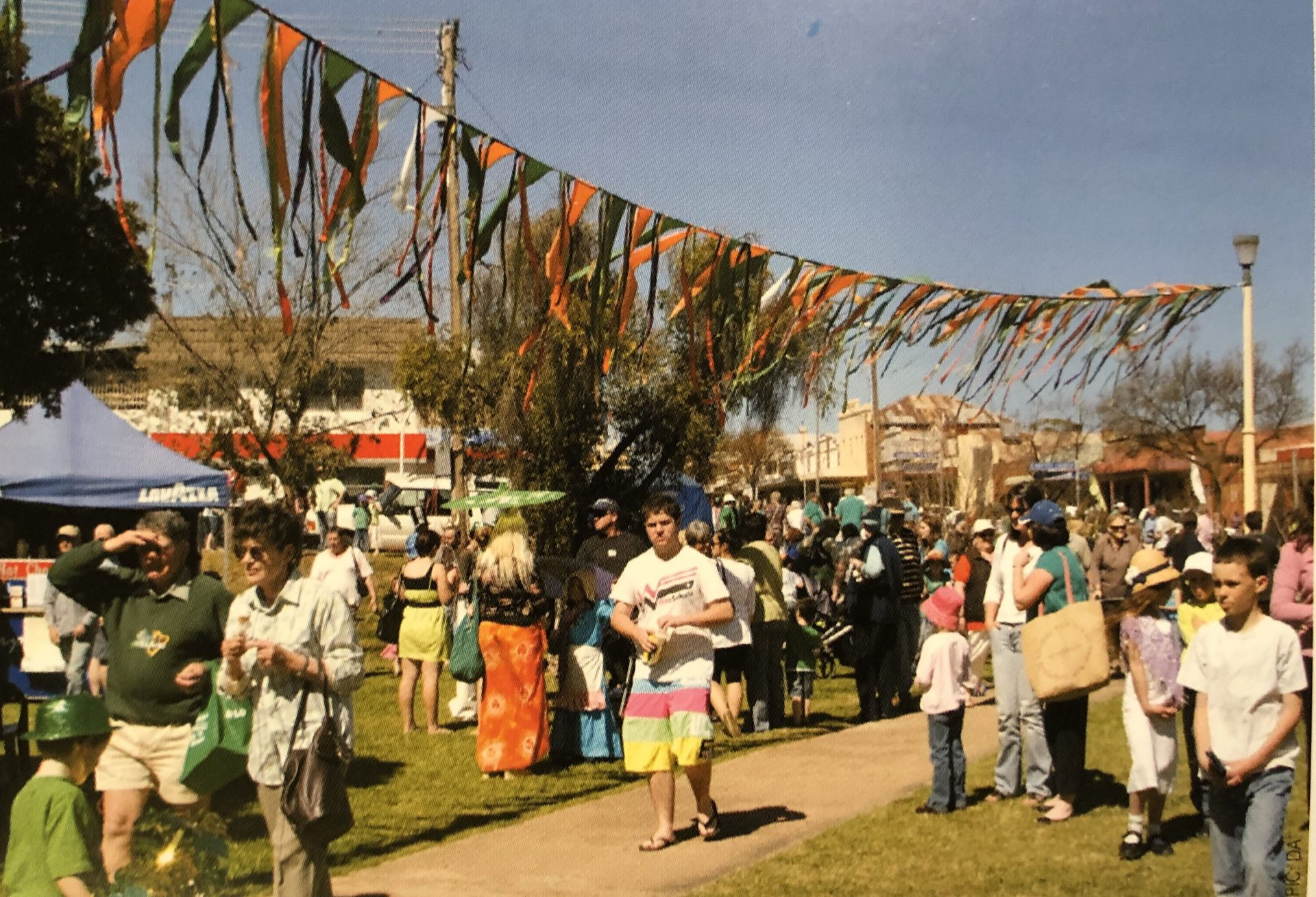 Crowd and stallholders at Turning Wave markets